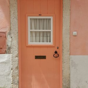 coral-door-in-Lisbon,-Portugal