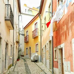 orange-narrow-street-in-Lisbon,-Portugal