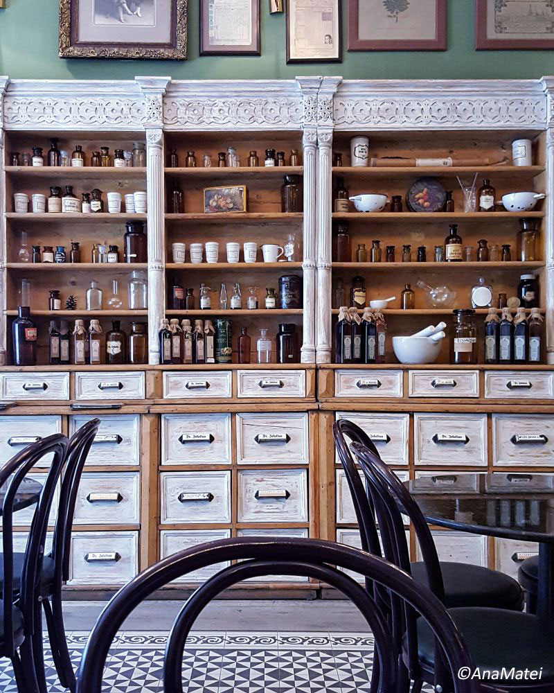 Dr.-Jekelius-Brasov---wood-cabinets-and-vintage-apothecary-bottles
