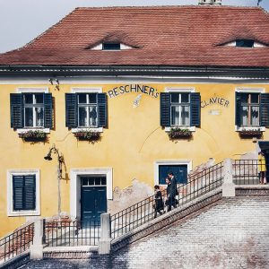 Sibiu-eyes-on-roofs---yellow-house