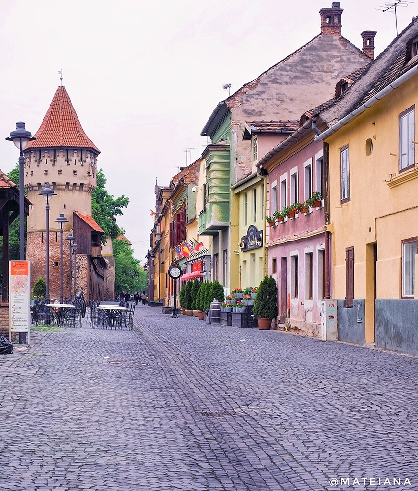 colorful-houses-and-defense-tower-on-the-most-beautiful-street-in-Sibiu
