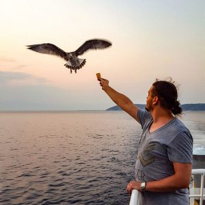 feeding-the-seagulls-on-the-ferry-boat-to-Thassos,-Greece