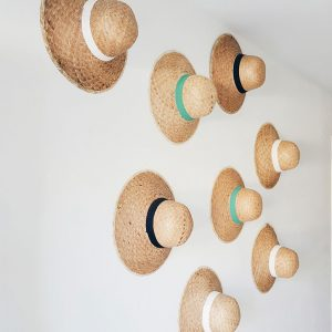 staw-hats-decor-in-the-lobby-at-La-Boheme,-Thassos
