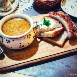 Kielbasa-sausage-and-Zurek-Soup-at-Zapiecek,-Warsaw