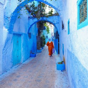 Blue-Streets-of-Chefchaouen---Woman-in-orange-djellaba