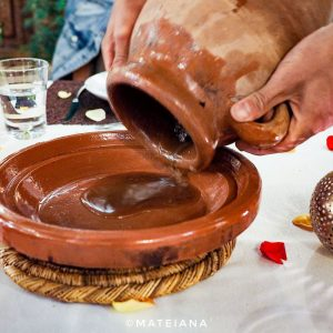 Lamb-Tanjia-being-poured-in-a-plate---Riad-Melhoun-and-Spa-Marrakech