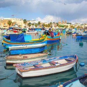 Blue-boats-in-Marsaxlokk,-Malta