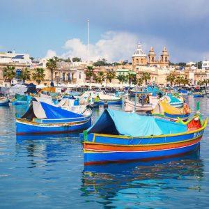 Blue-boats-in-Marsaxlokk-s-Bay,-Malta
