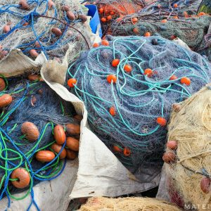 Colorful-fishing-nets-in-Marsaxlokk,-Malta