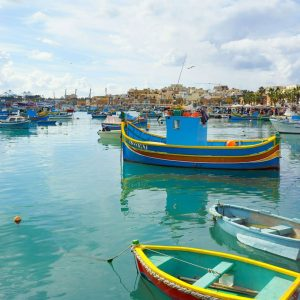Marsaxlokk,-Malta---blue-boats-and-the-bay