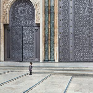 Little-Girl-in-front-of-Hassan-II-Mosque,-Casablanca,-Morocco