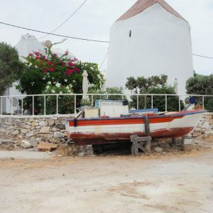 Windmill and old boat in Naousa, Paros